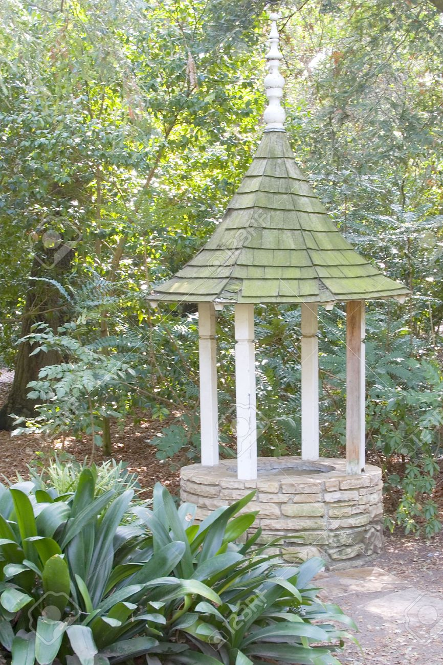 An Old Wishing Well, In Need Of Repair, Tucked In A Shady Part Of