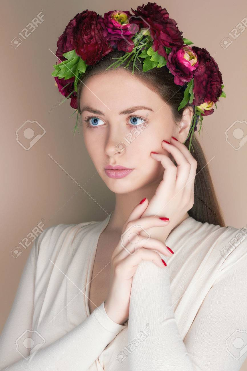 Young woman with flowers crown beauty model girlautiful girl stock photo young woman with flowers crown beauty model girlautiful girl with flowers on her headspring hairstyle izmirmasajfo