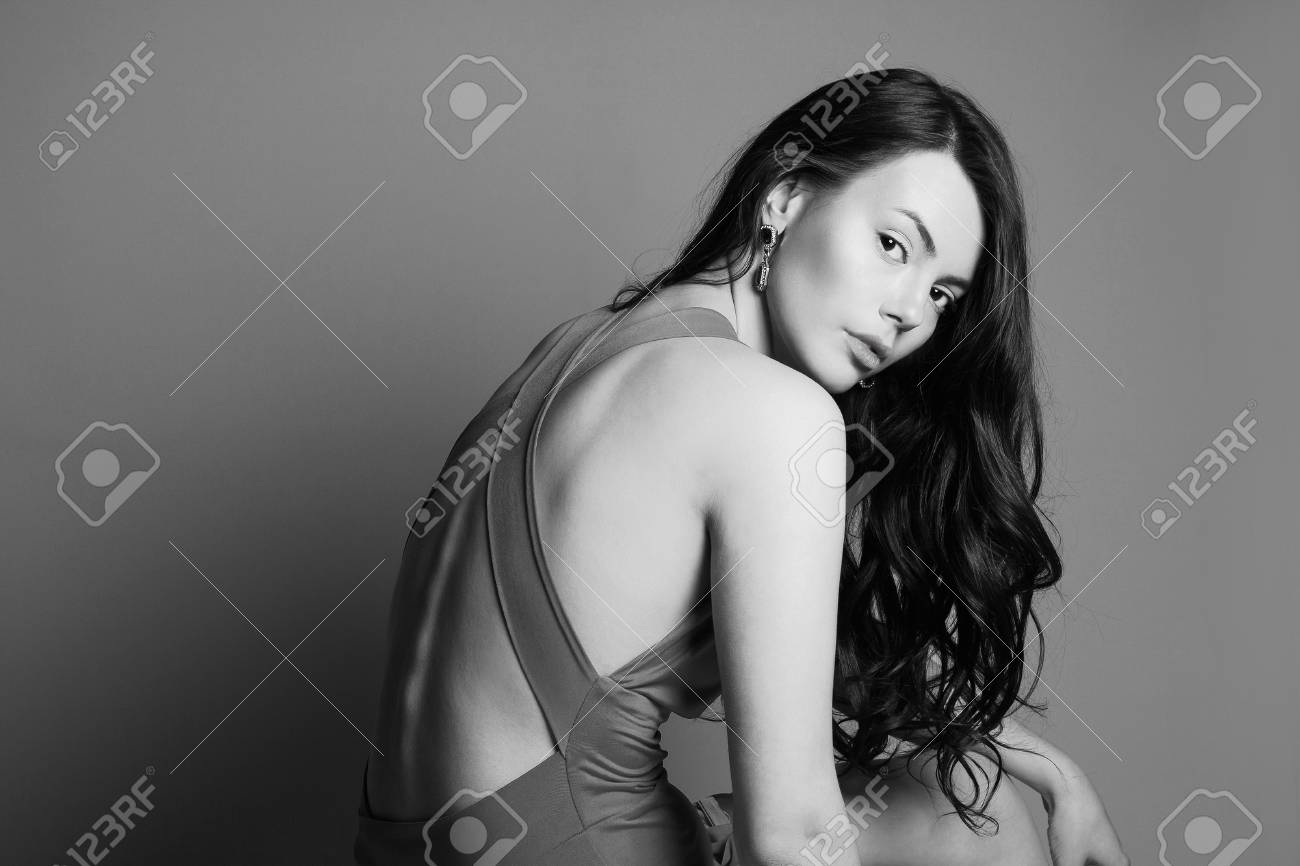 monochrome portrait of beautiful young brunette woman.fashionable..