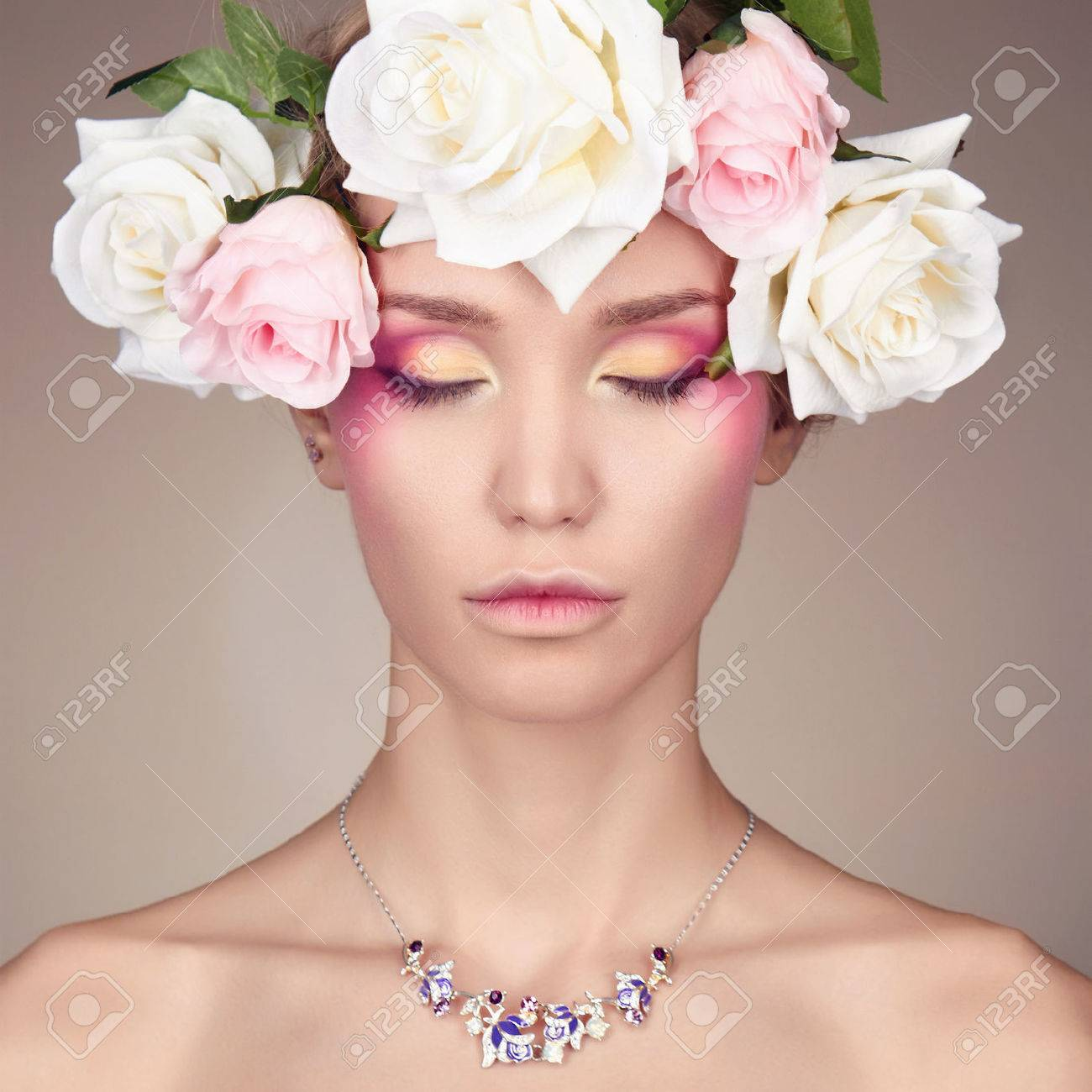 Young woman with flowers crown beauty model girlautiful girl stock photo young woman with flowers crown beauty model girlautiful girl with flowers on her headofessional make up izmirmasajfo
