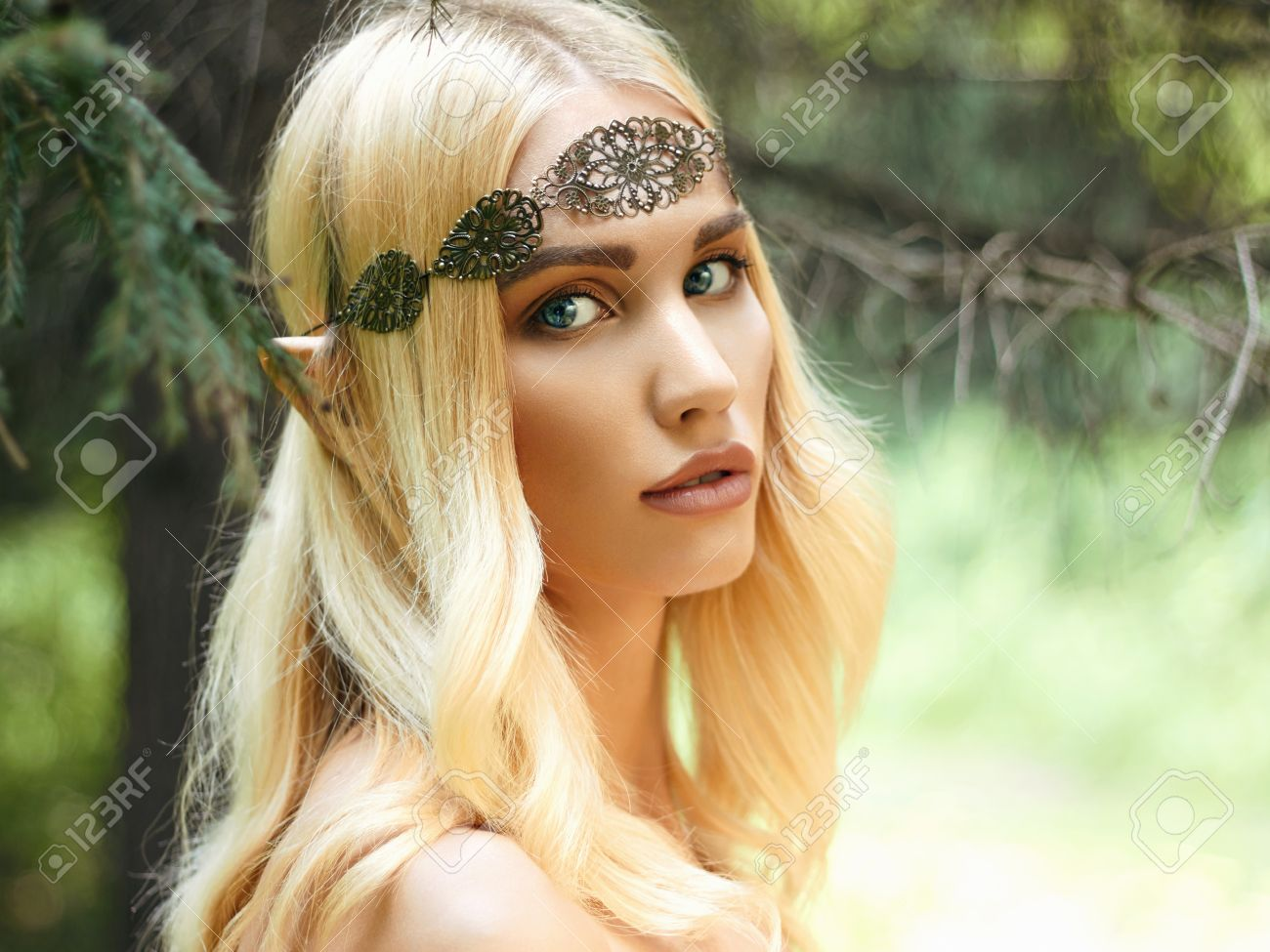 beautiful elf ears fantasy young woman in woods stock photo