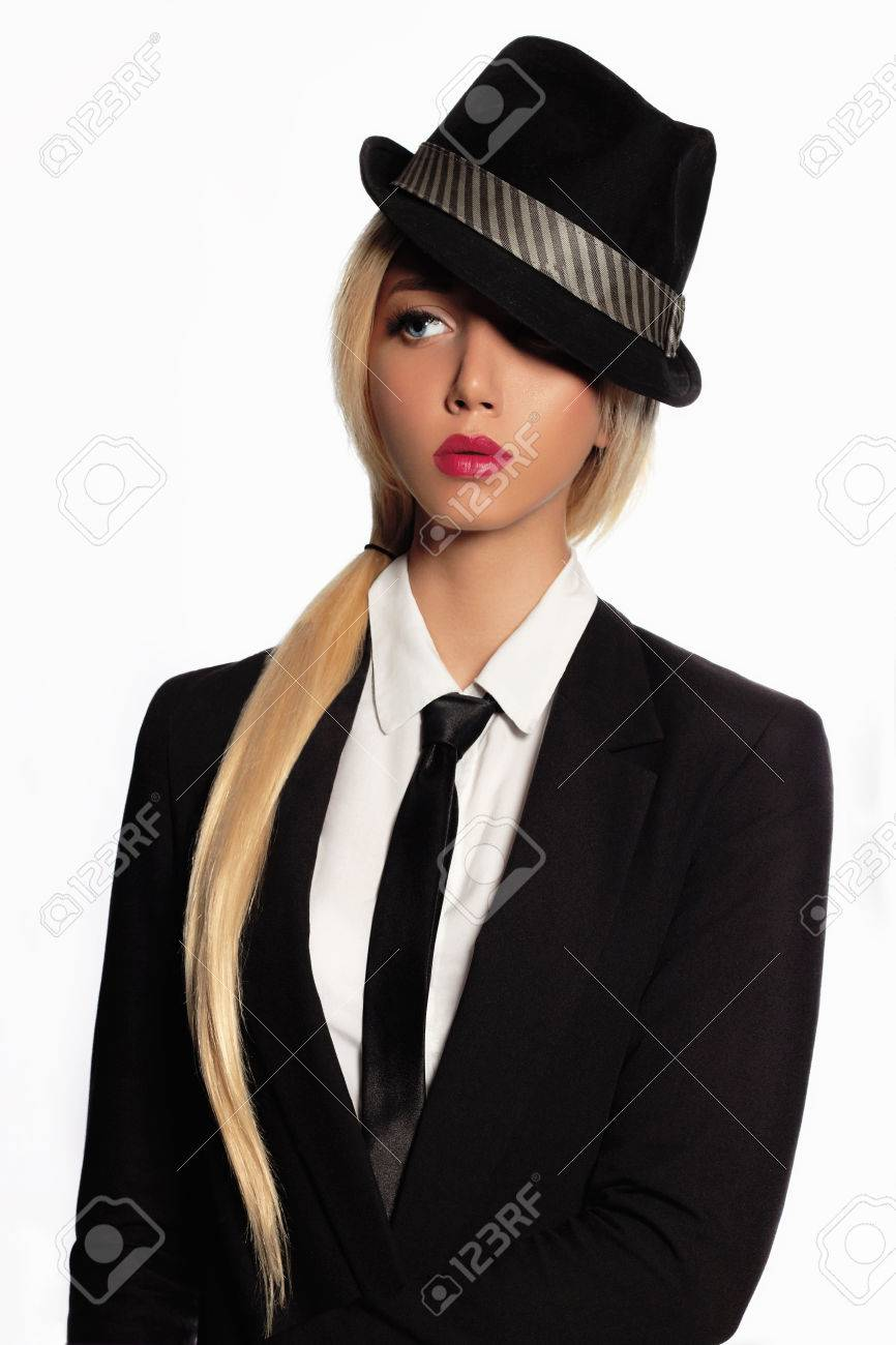 5ce43e0e6f2 beauty business woman in formal suit and tie.beautiful blond girl in black  hat Stock