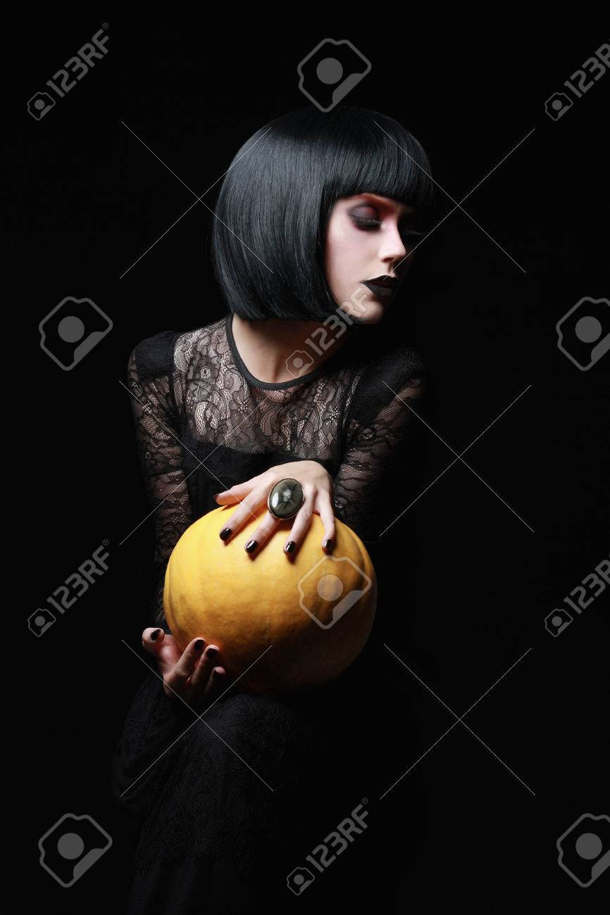 sexual brunette witch in night of halloween gothic woman with bob hair girl with
