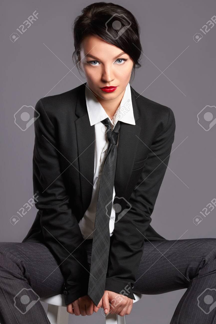 b59c617d845b beauty woman in formal suit and tie. studio shot of beautiful girl in suit.