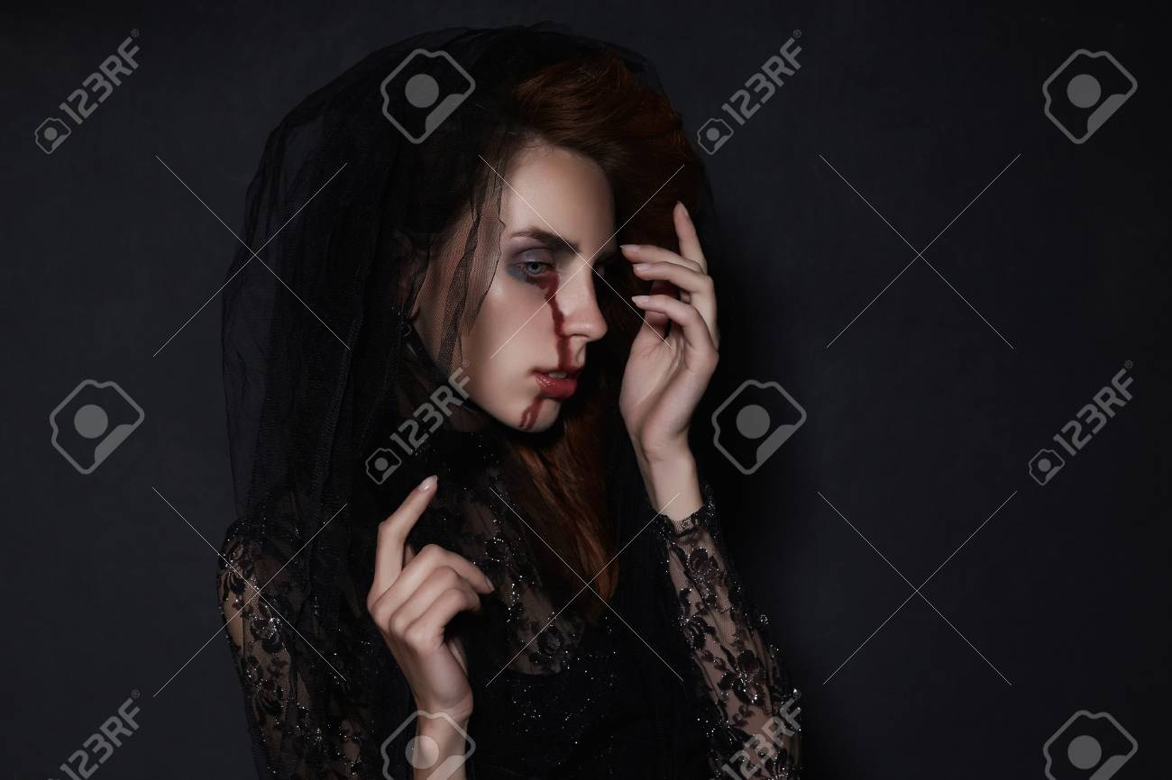stock photo woman in black veil with a bloody face make uphalloween costumeblack widow