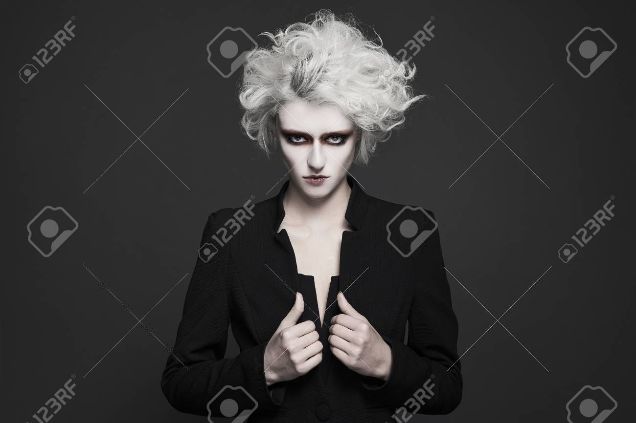 fashion young woman with white skin and hair with clown make-up.freaky halloween make-up style girl - 94431927