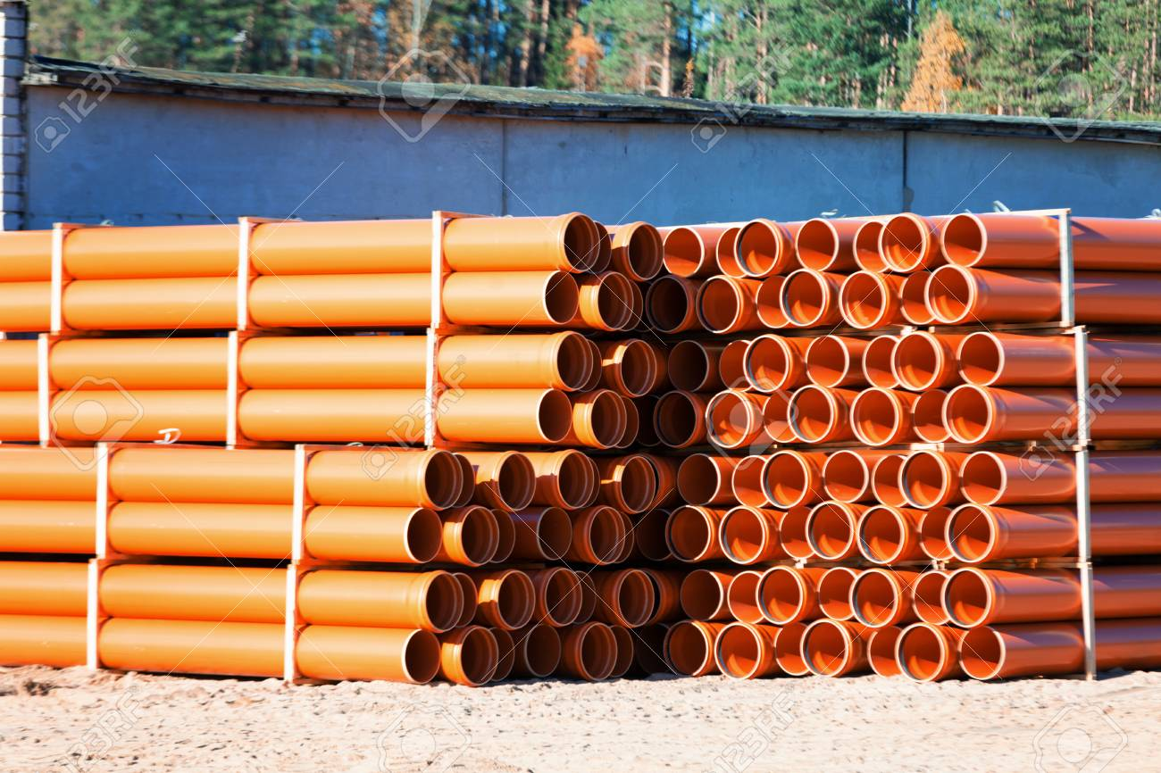 background of colorful big orange plastic pipes for hot water used at the building site close & Background Of Colorful Big Orange Plastic Pipes For Hot Water ...