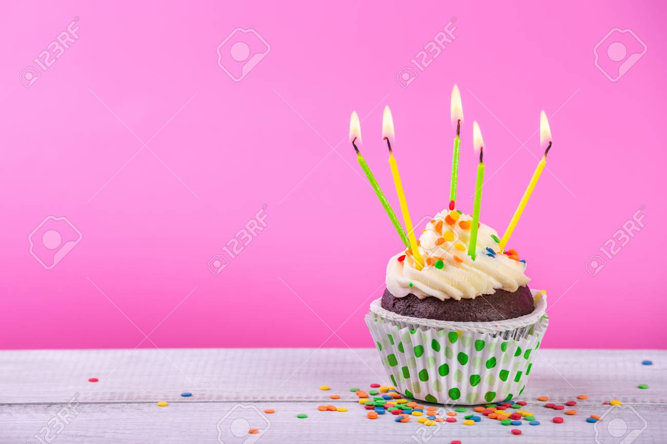 Birthday Cupcake On A Color Background With Multicolor Candles