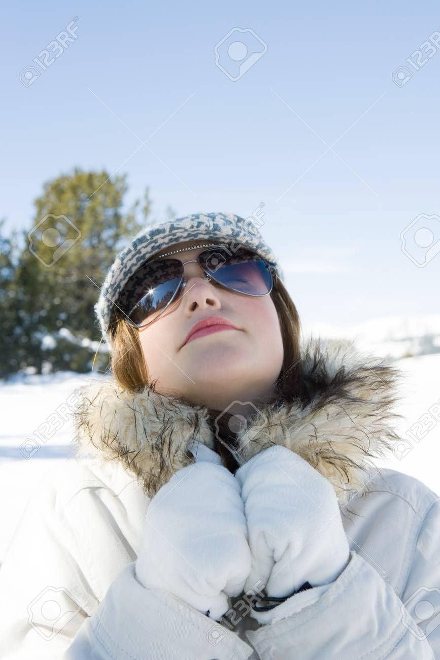 1c3b4206398d Teenage Girl Wearing Parka And Sunglasses In Snow