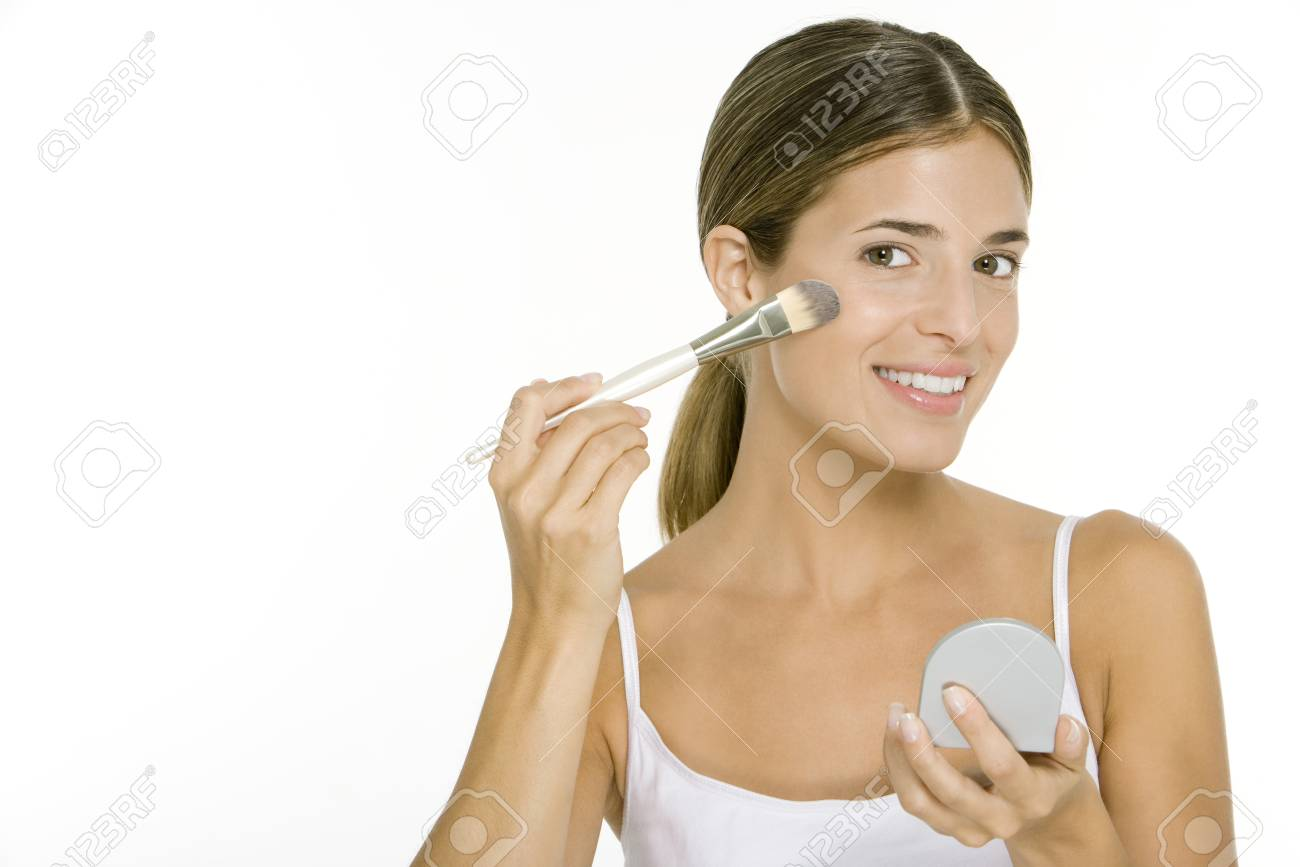 woman holding hand mirror. Stock Photo - Woman Applying Blush, Holding Hand Mirror, Smiling At Camera Mirror :