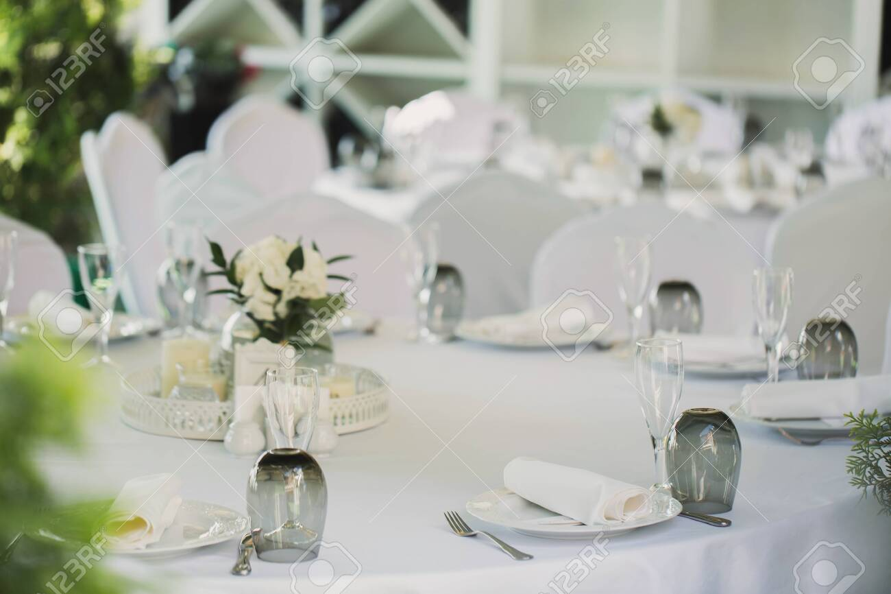 Beautifully decorated tables for guests with decorations - 142708031