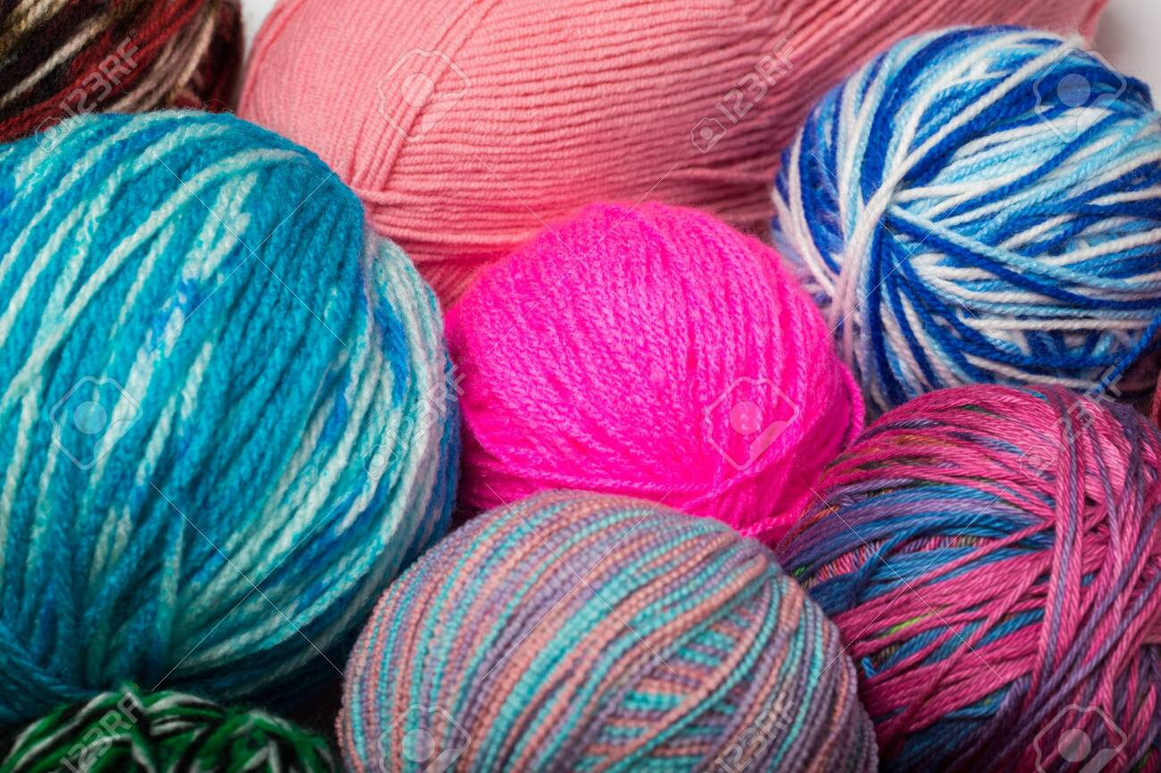 Colored balls of yarn. View from above. Rainbow colors. All colors. Yarn for knitting. Skeins of yarn. - 143423223