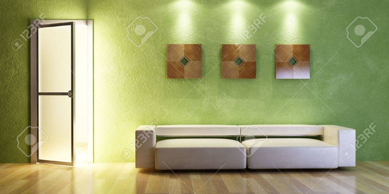 the modern couch beside the wall with green stucco stock photo