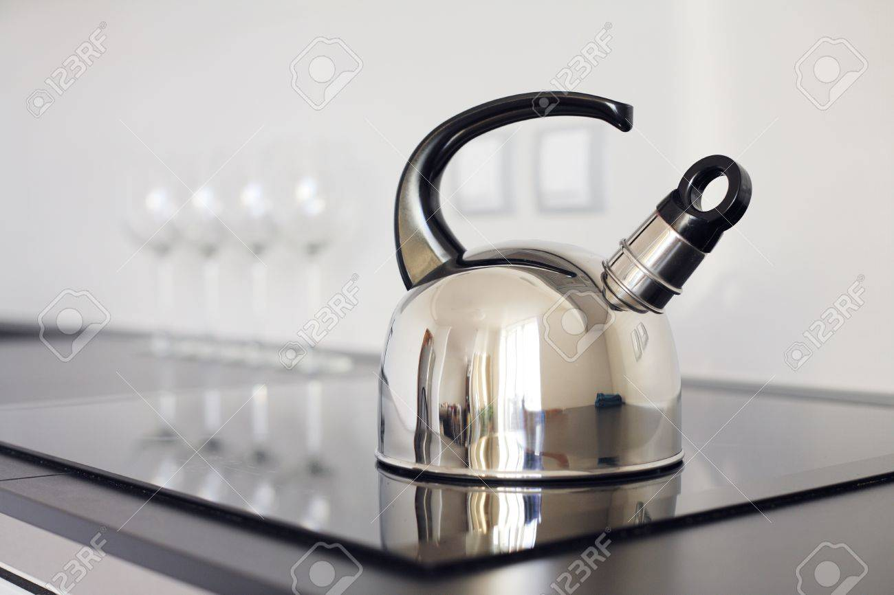 modern kettle on the stove stock photo picture and royalty free  - stock photo  modern kettle on the stove
