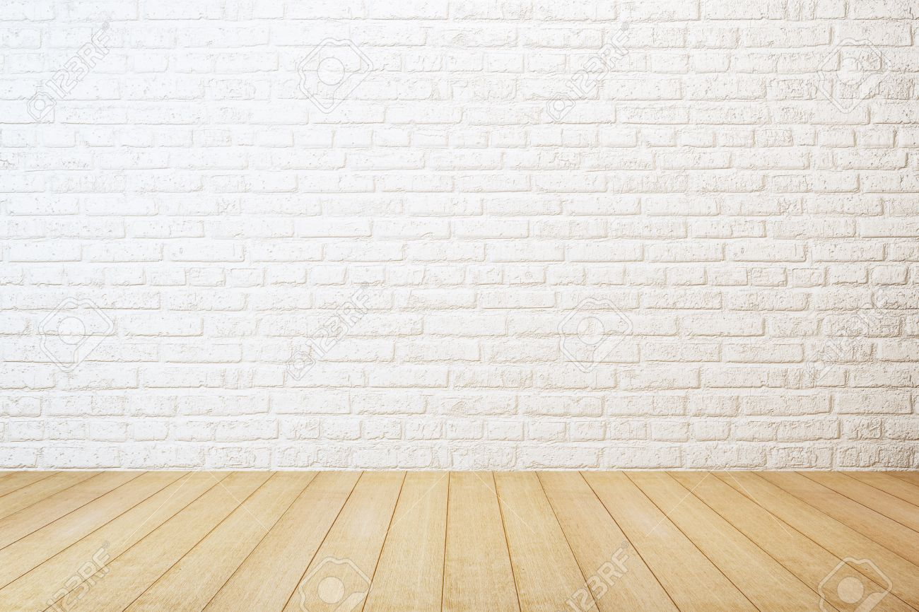 empty room with white brick wall and wooden floor stock photo