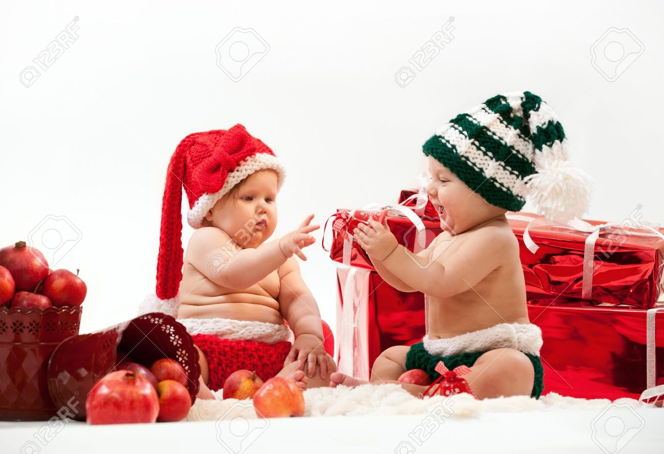 Two Cute Babies In Christmas Costumes Stock Photo, Picture And ...