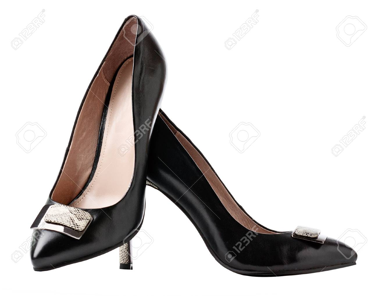 Pair of black female shoes over white Stock Photo - 12376602
