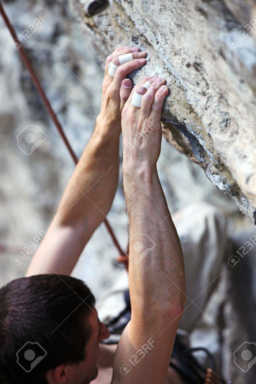Closeup view of a rock climber s hands on a cliff Stock Photo - 16951217