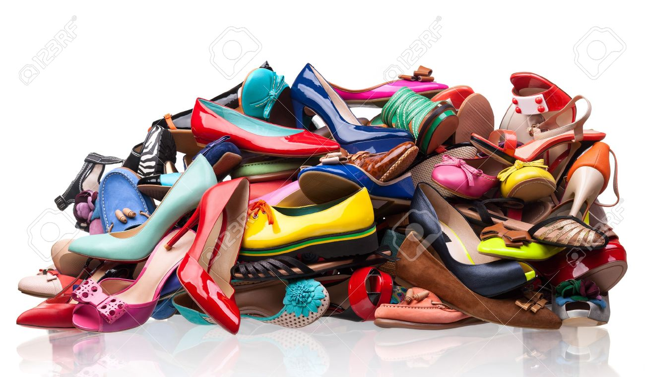 Pile of various female shoes over white Stock Photo - 17665280