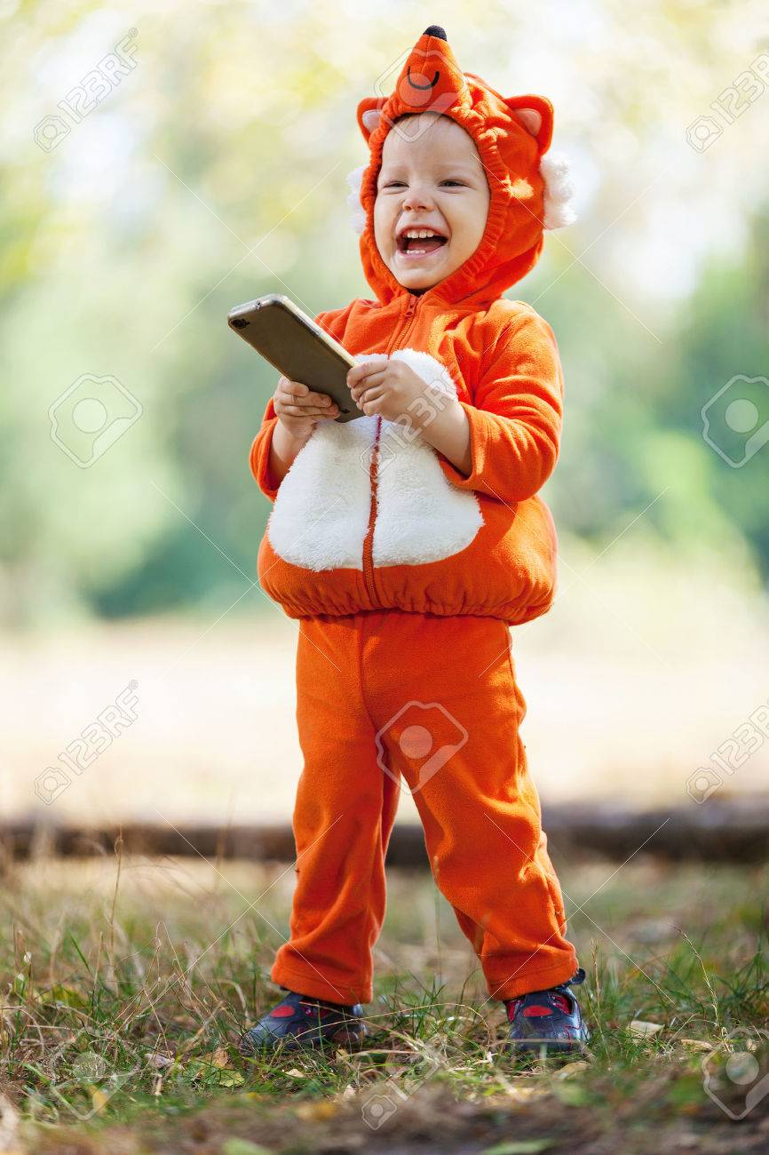 Joyful toddler boy in fox costume holding smartphone Stock Photo - 33744661  sc 1 st  123RF.com & Joyful Toddler Boy In Fox Costume Holding Smartphone Stock Photo ...