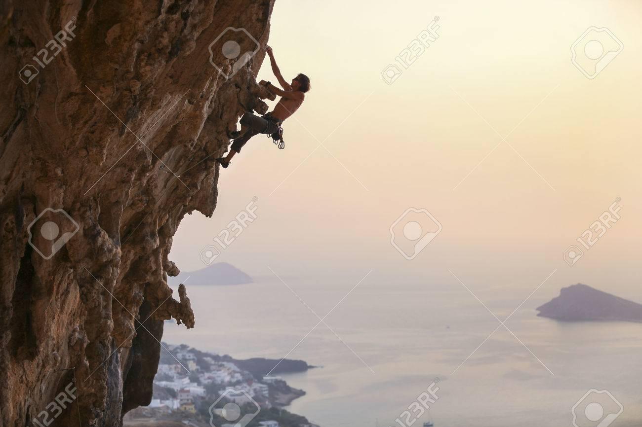 Male rock climber at sunset, Kalymnos Island, Greece - 49254019