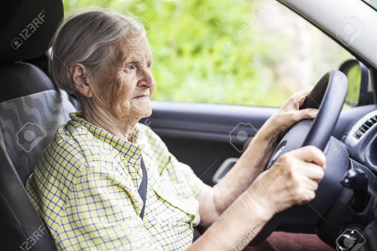 Senior woman driving a car - 48996456