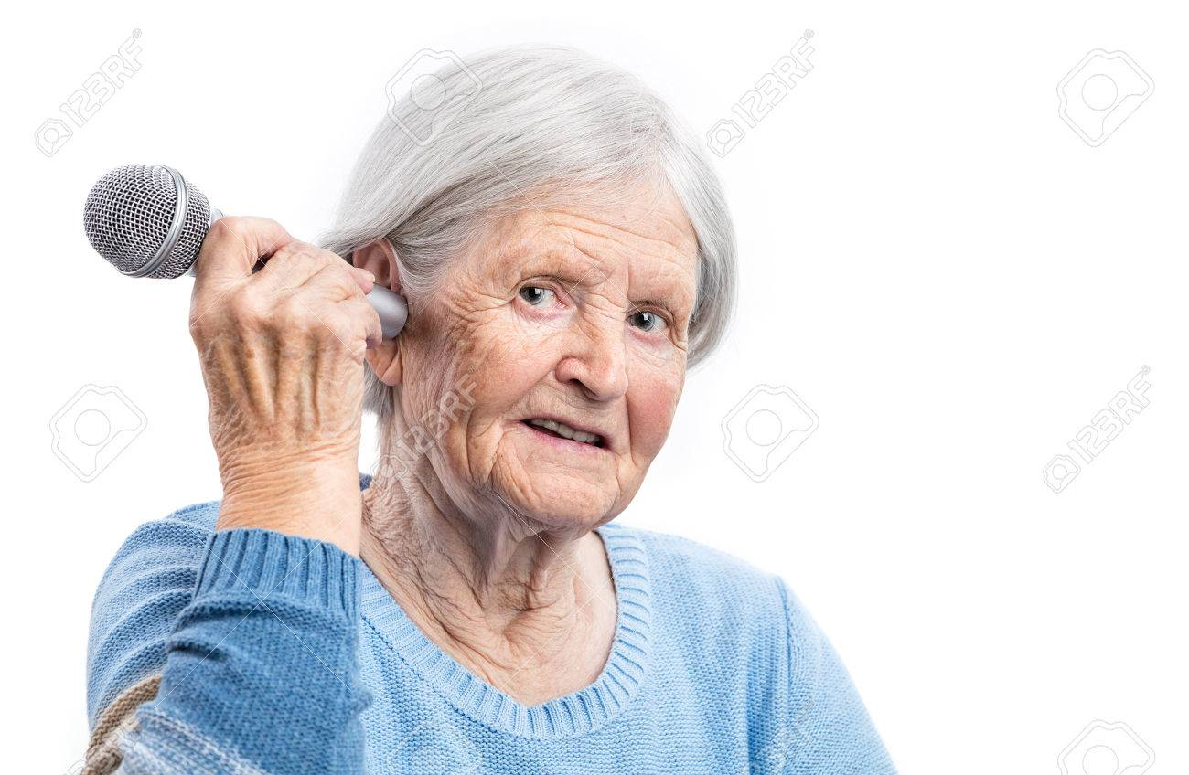 Elderly woman holding microphone close to an ear hearing problems elderly woman holding microphone close to an ear hearing problems stock photo 49903286 publicscrutiny Choice Image