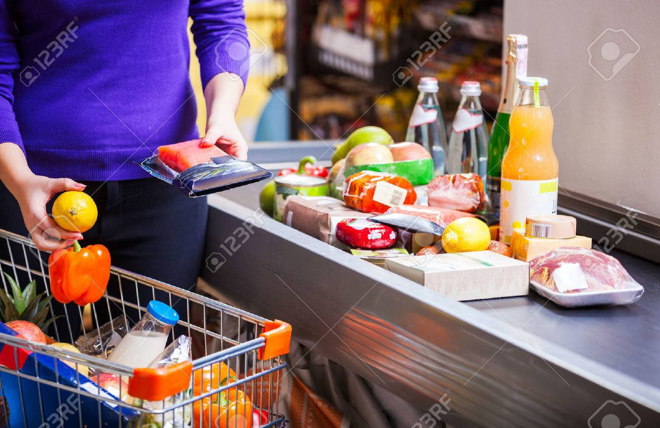 Young couple before checkout in supermarket - 55687369