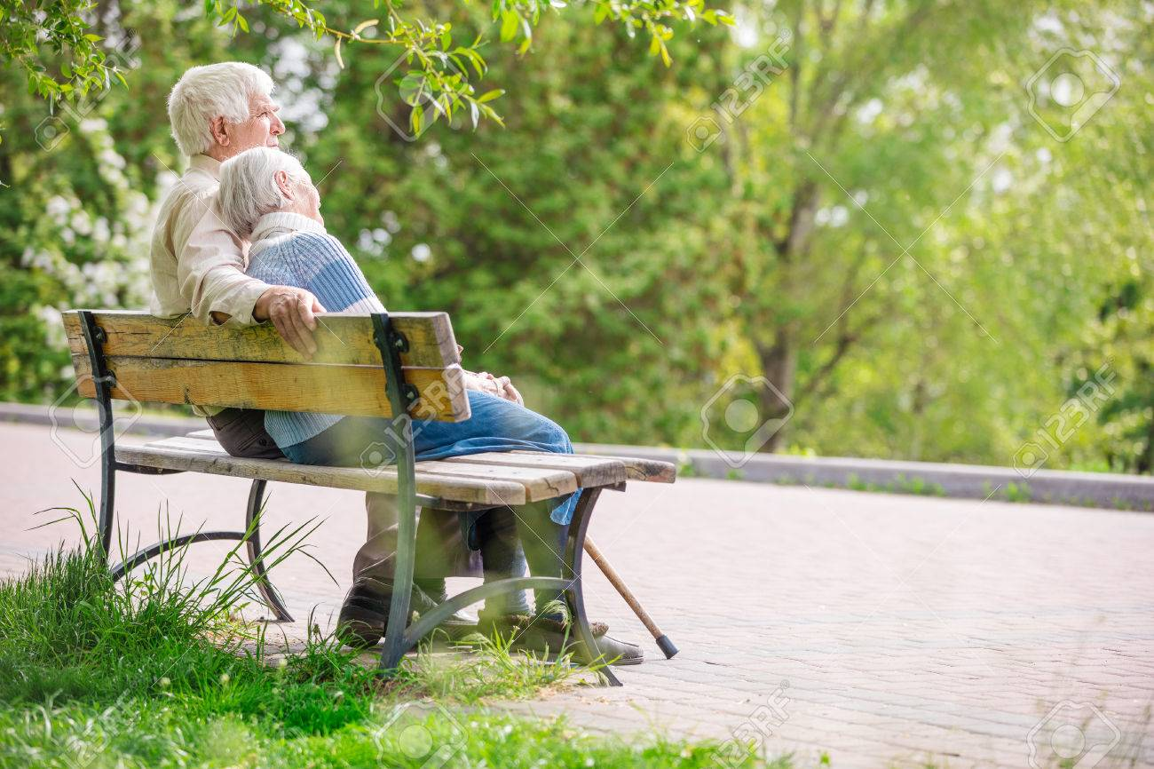 Elderly couple resting at the park - 58629402