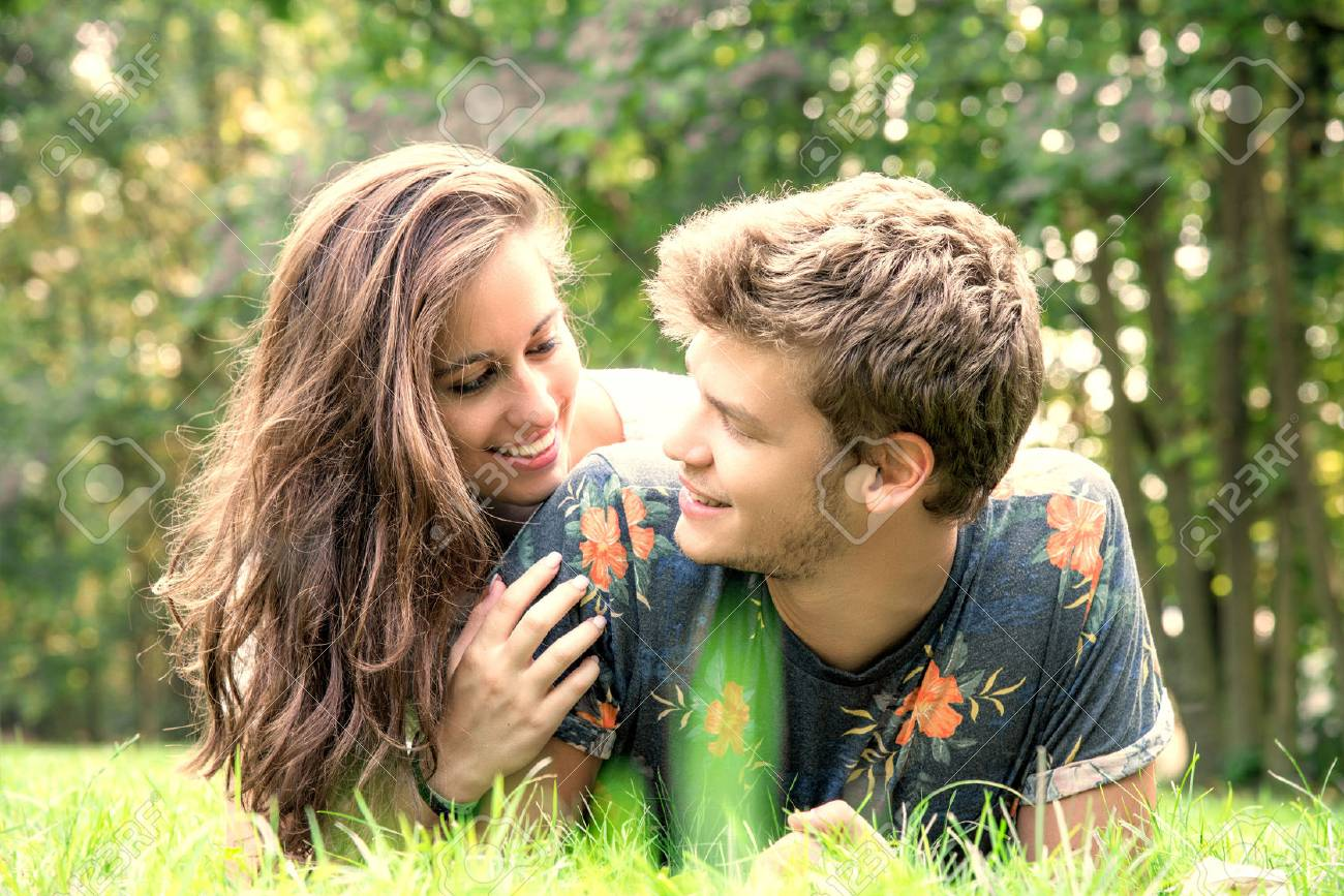 young couple has fun in the park - 87742237