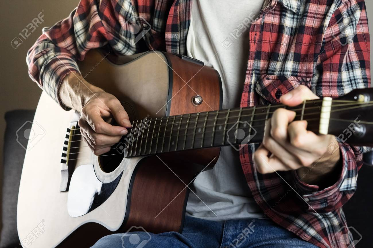 Male Hands Playing Chord On Acoustic Guitar Stock Photo Picture And
