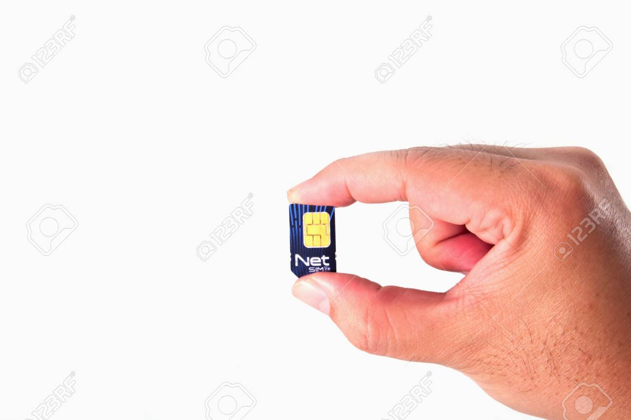 Net Sim card In a hand isolated on white background Stock Photo - 12837729