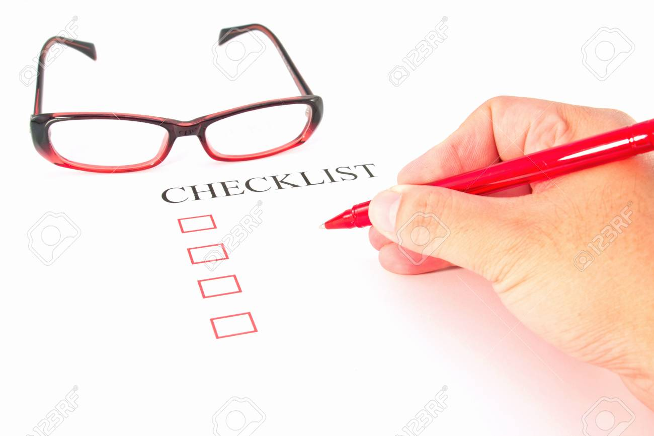Checklist with pen, glasses and checked boxes Stock Photo - 13105243