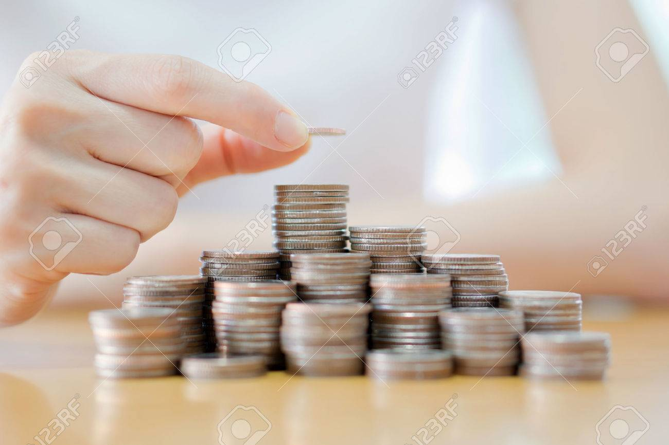 Hand put coins to stack of coins on white background - 51186747