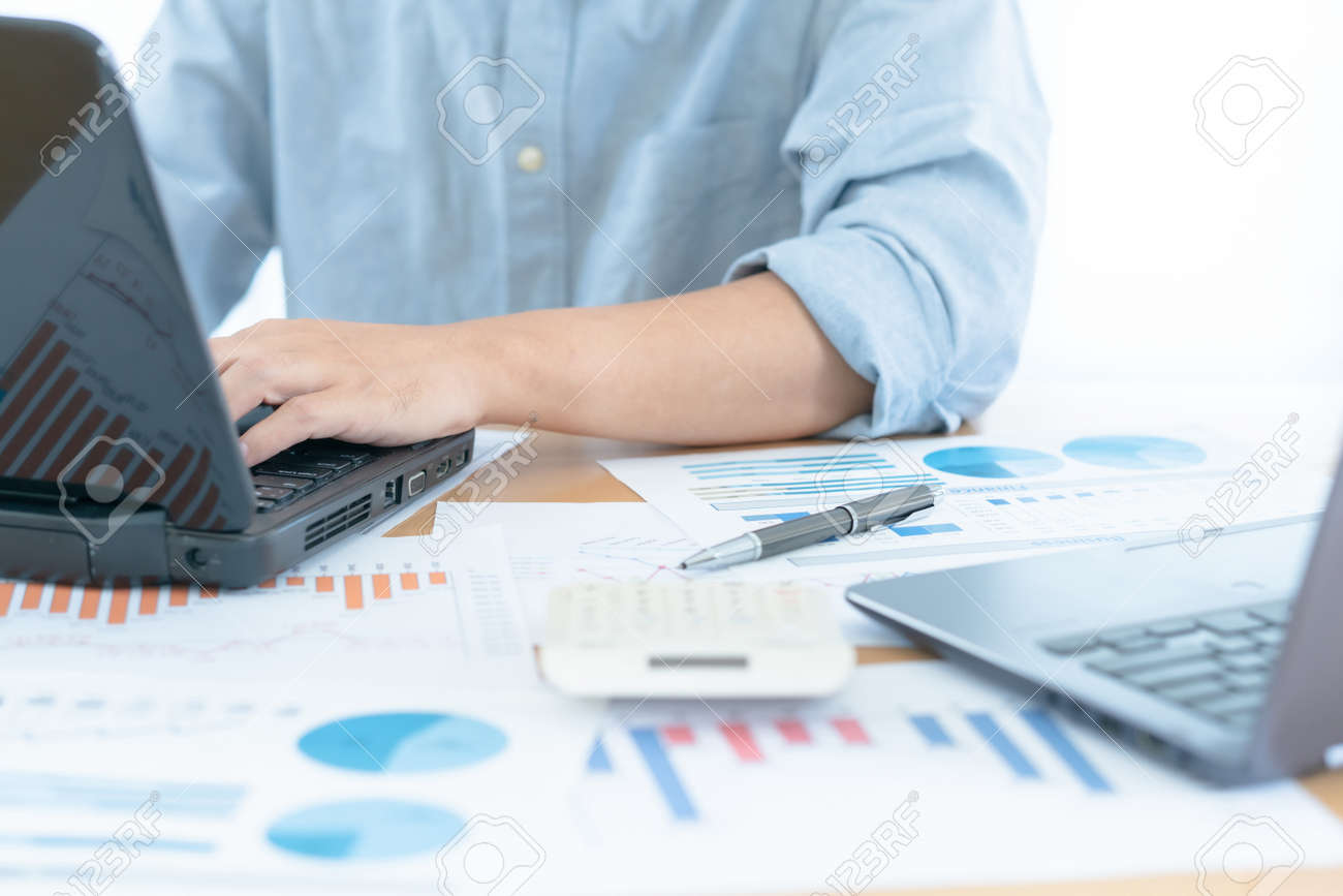 Businessman hands on the keyboard working to analysis business data, finance document with laptop computer on desks, business concept, - 167812425