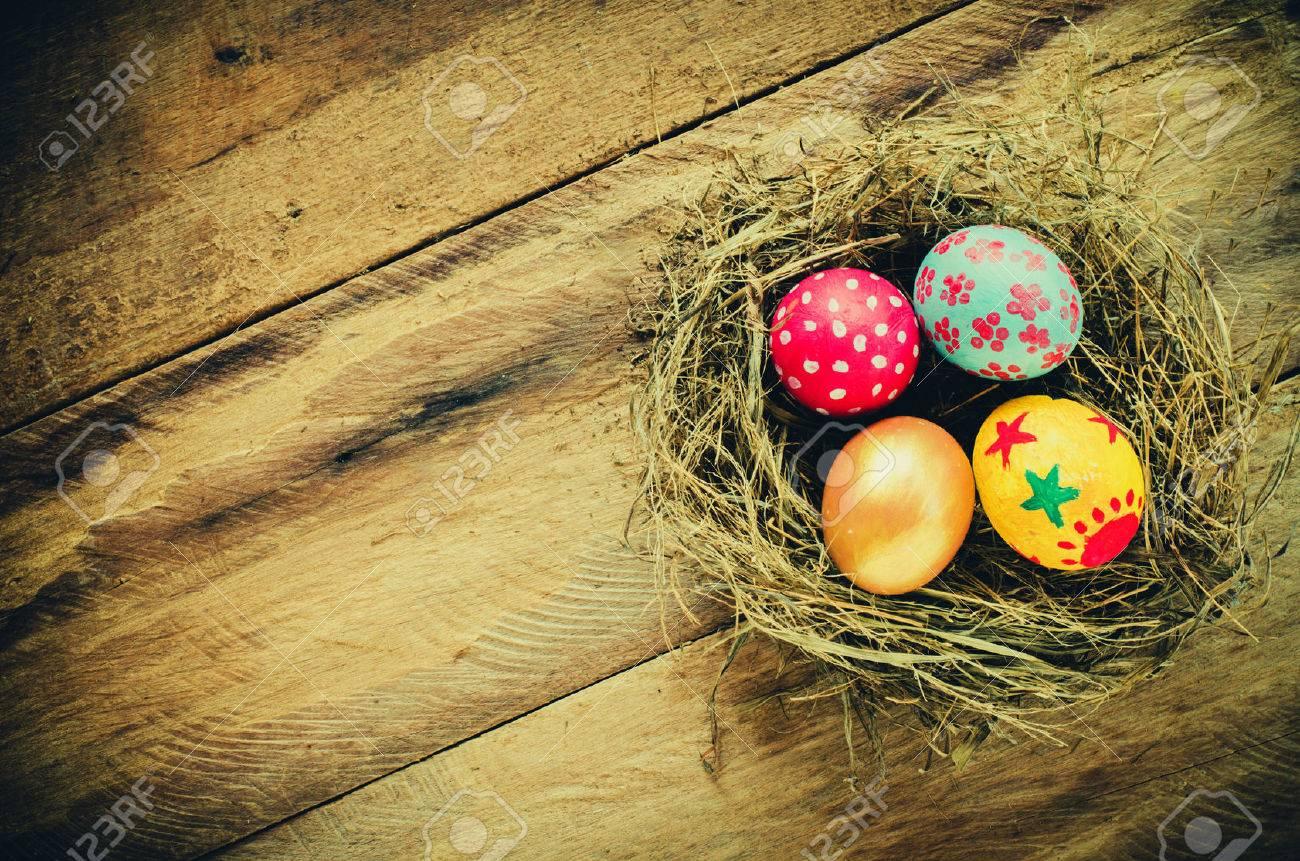 Easter eggs in nest on wooden background - 39491581