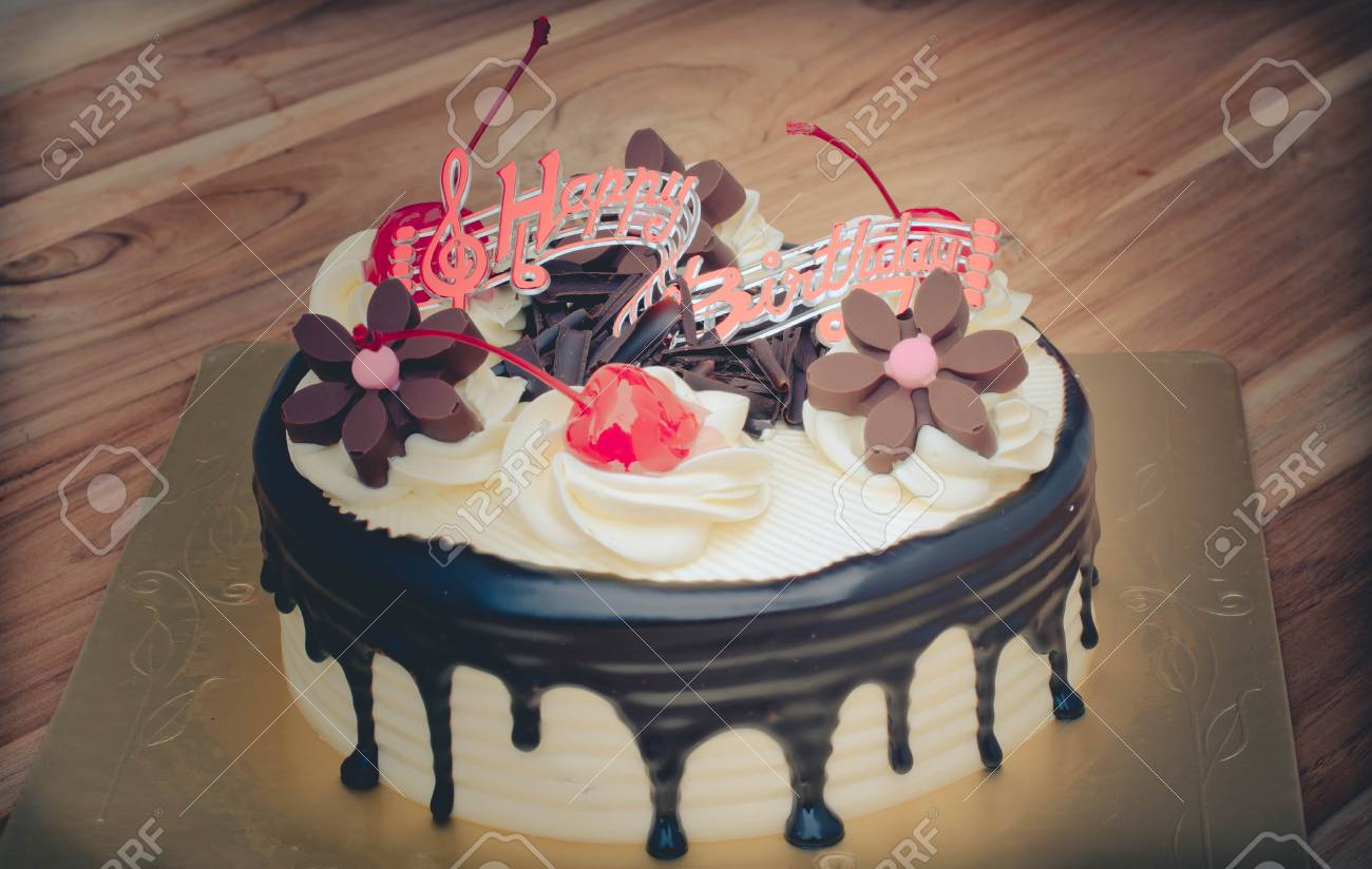 Birthday Cake Vanilla Chocolate Cherry Was Divided Pieces On A Wooden Table Stock Photo