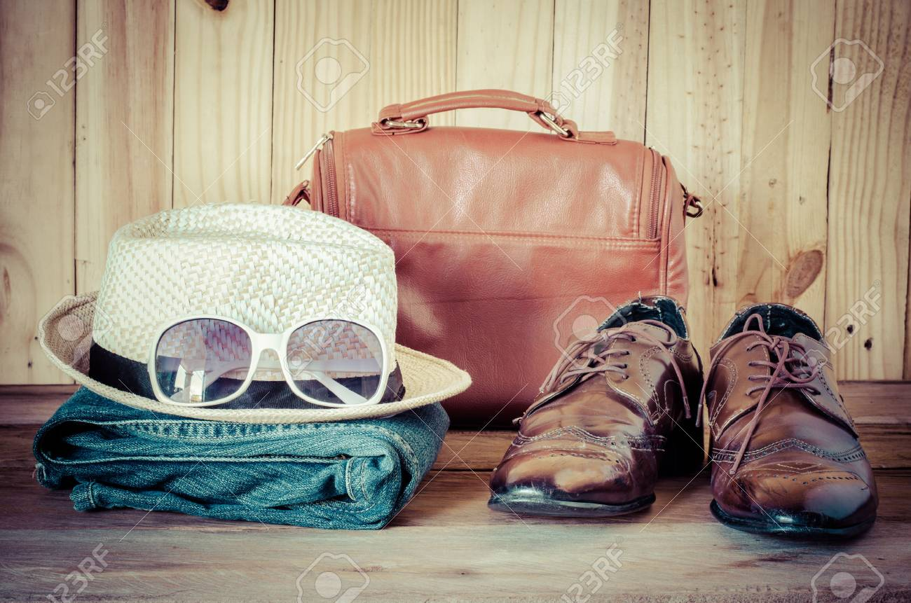 Travel,accessories, jeans, hats,shoes,sunglass, ready for the trip on wooden backgrond - 52524685