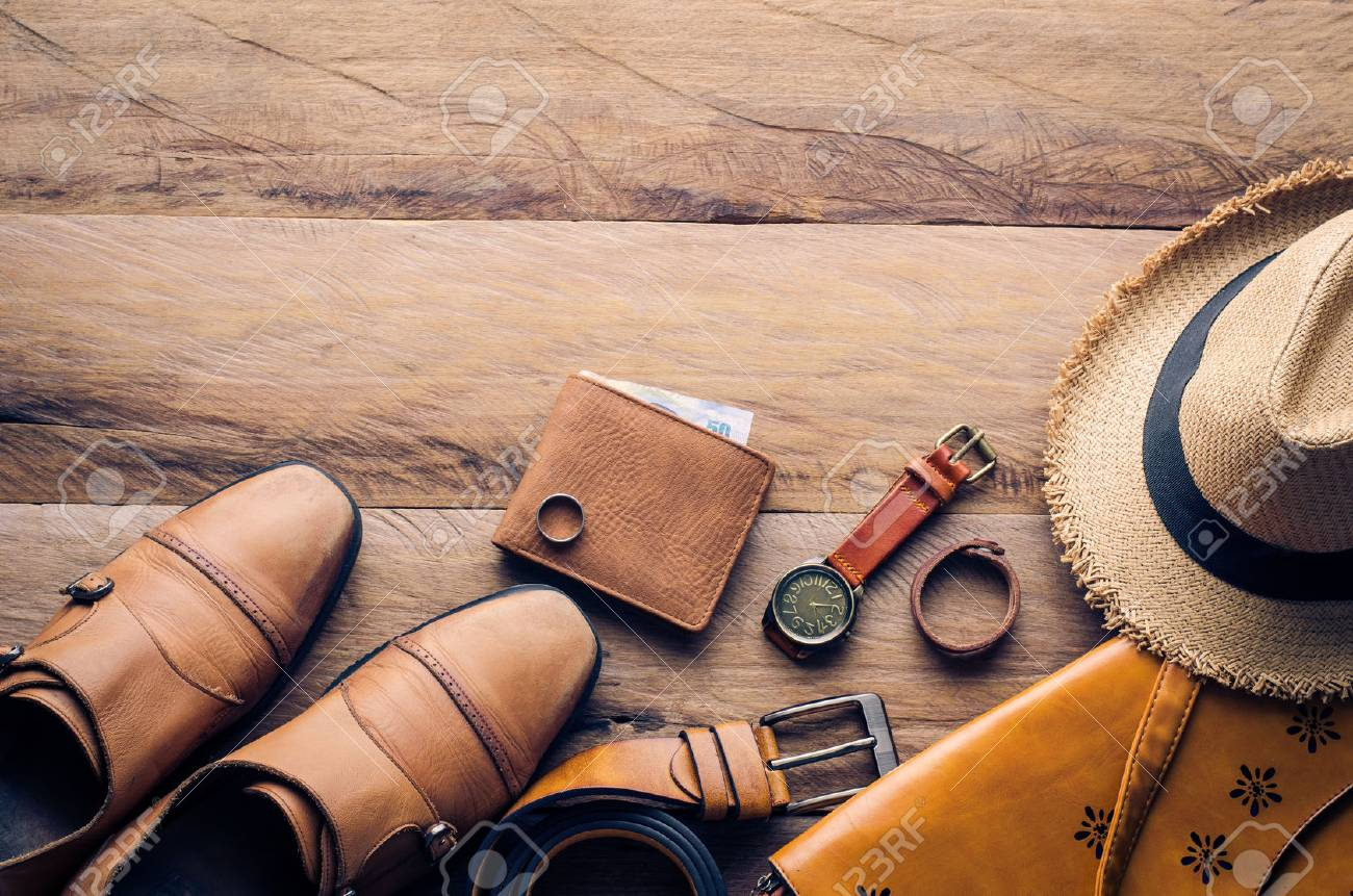 Clothing and accessories for men on wood floor - 63312478