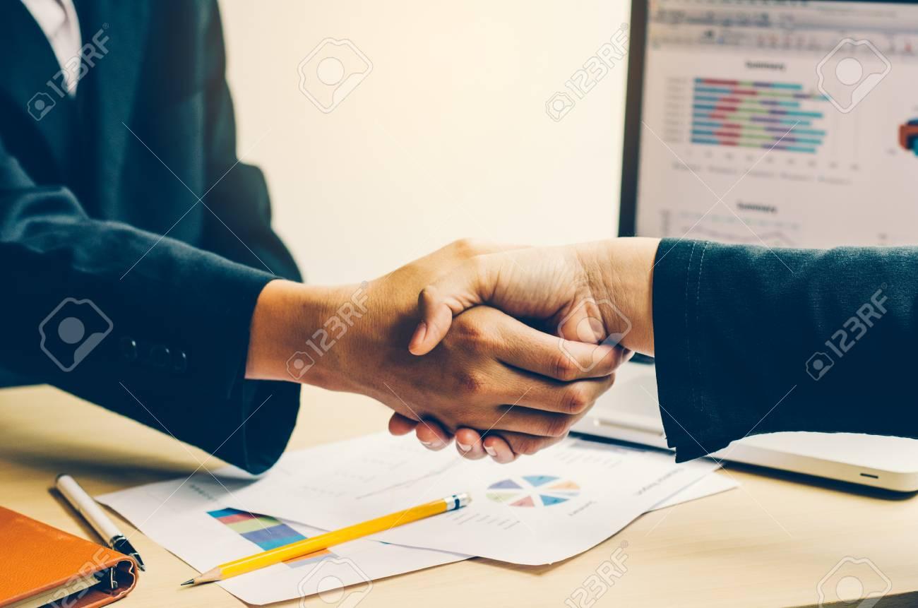 Handshake between joint venture businessmen after good management and have good concept - 86578480