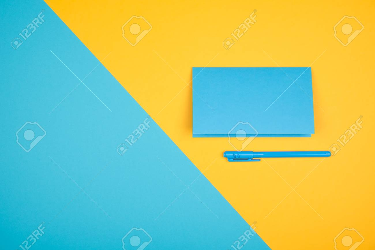 Empty Blue Greeting Cards With Pen On Contrast Yellow And Blue