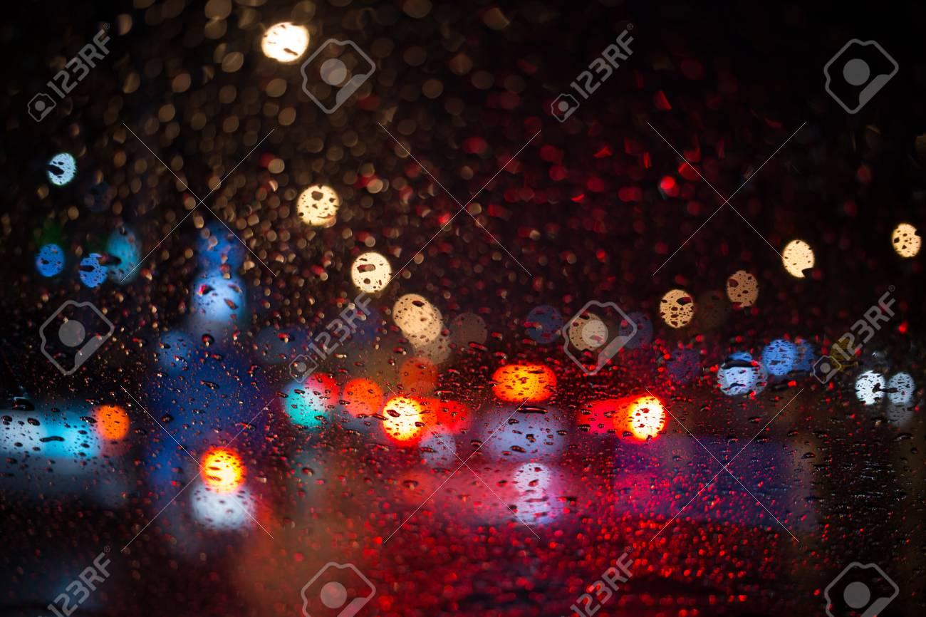 Rain Drop With Street Colorful Traffic Lights At Night Blur Bokeh