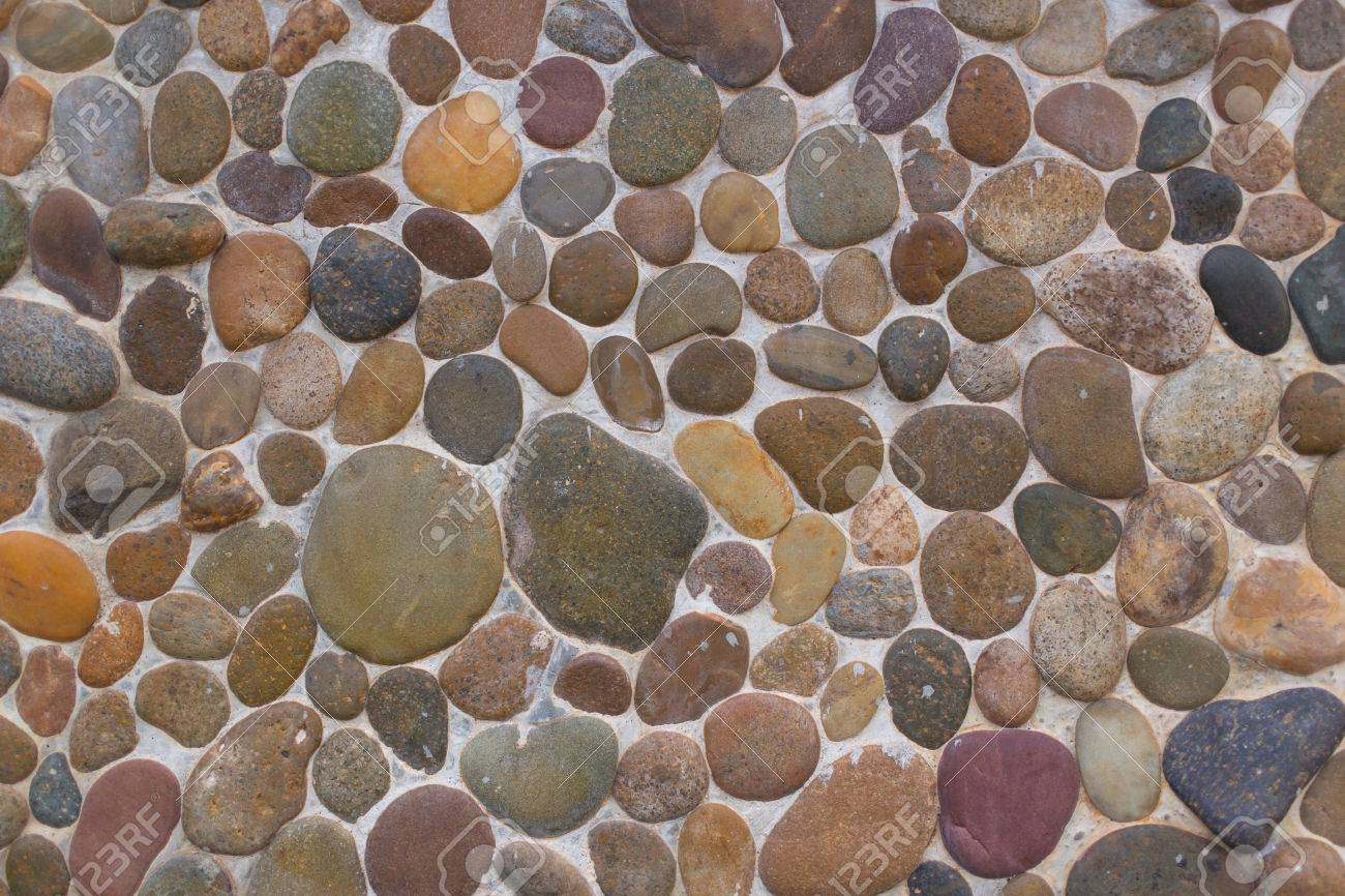 Elegant River Stone Or Rocks Wall Background Or Texture For Design Stock Photo    63929922