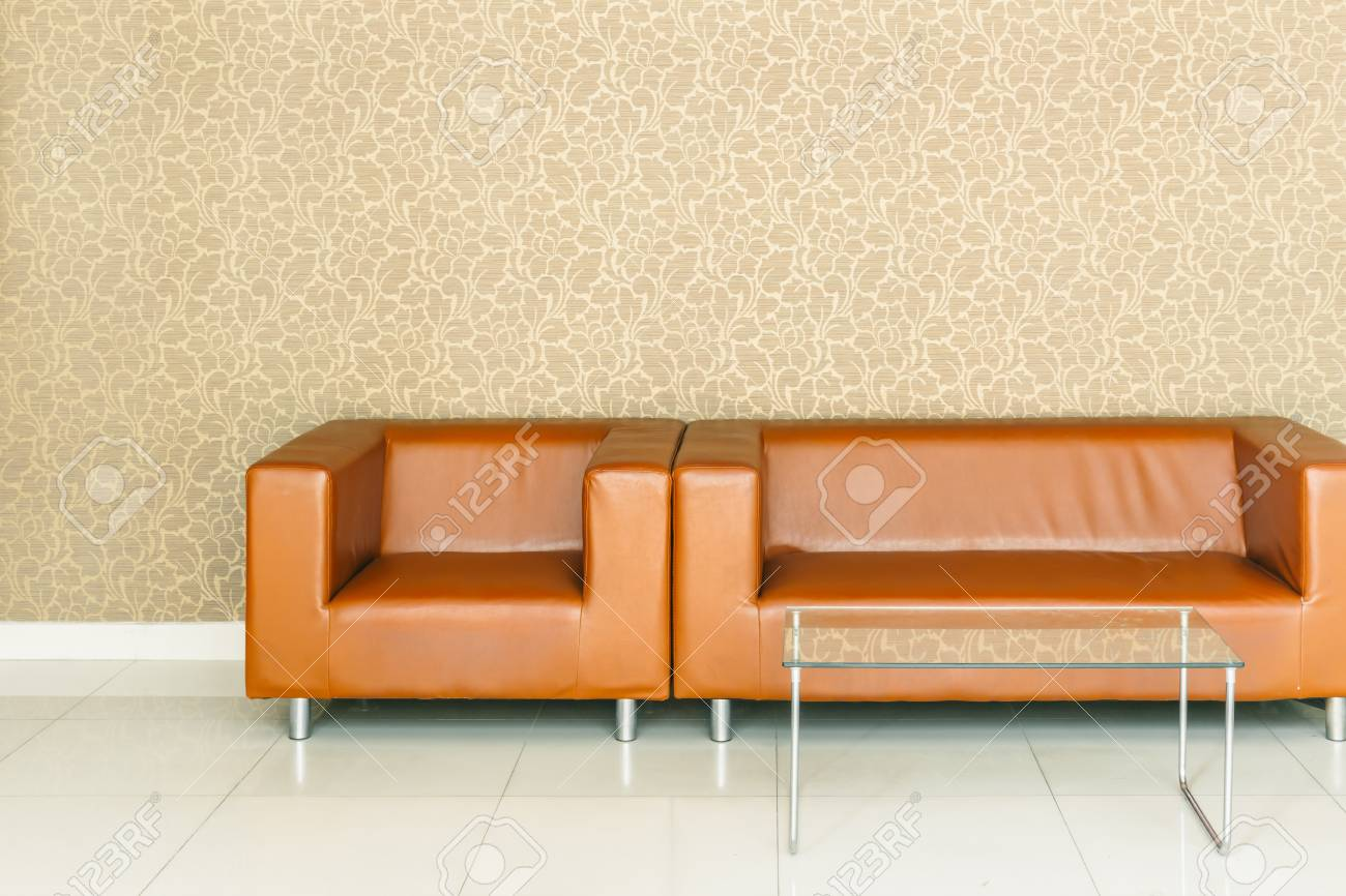 modern retro brown leather sofa with luxury golden background..