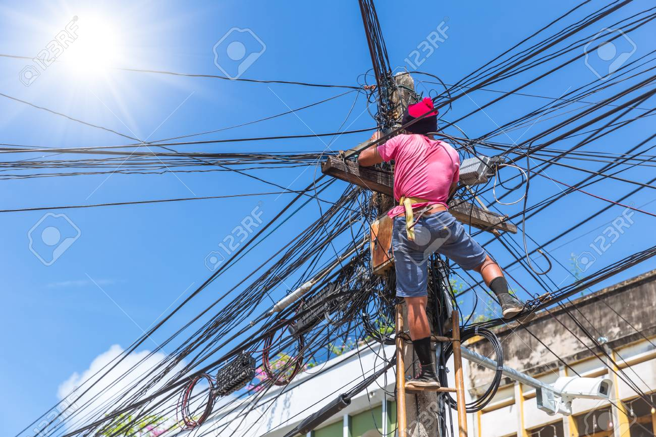 No Safety Worker Technician Installing Internet Cables On The ...