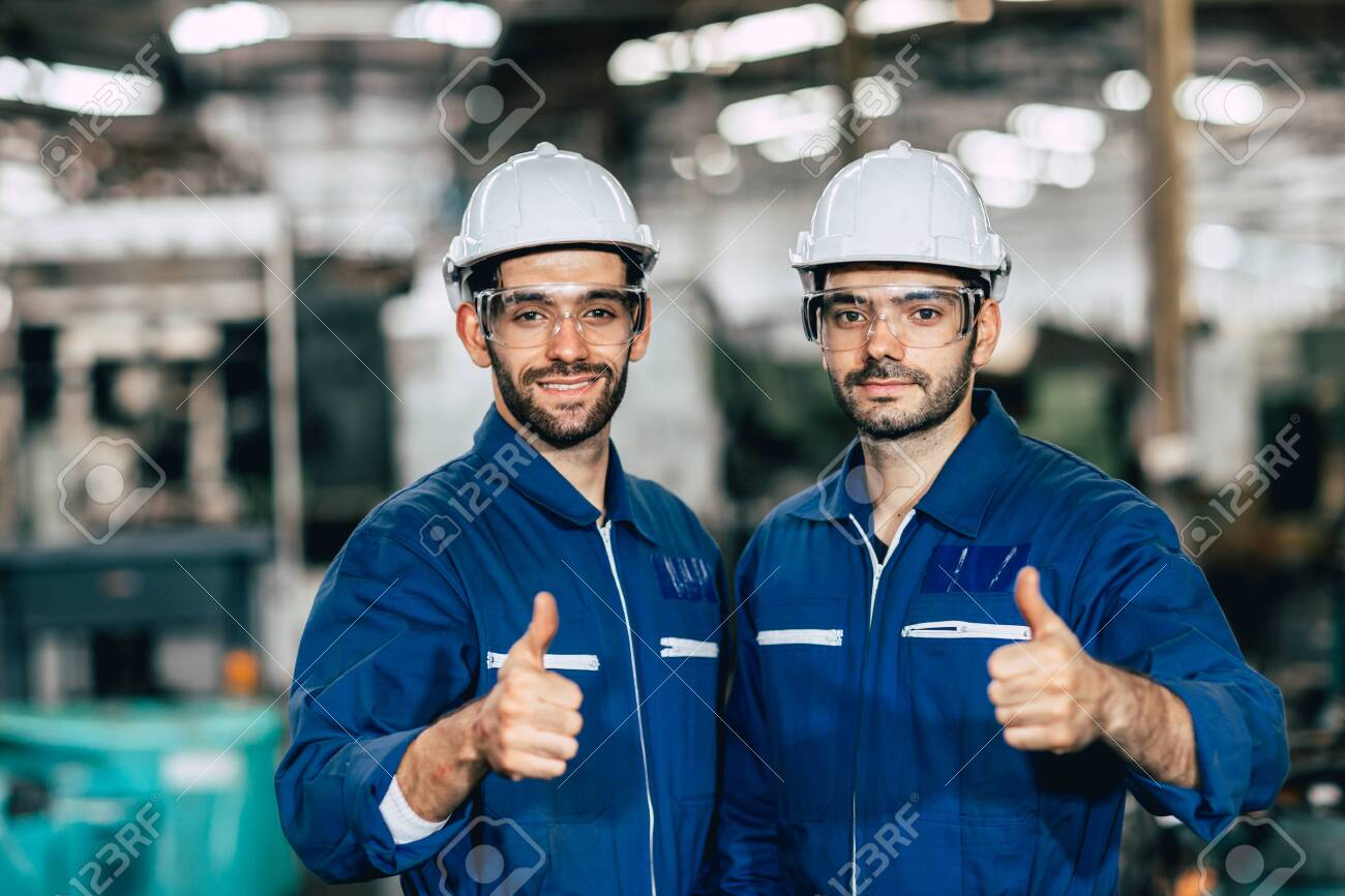Happy worker team smiling hand show thumb up for good working in factory. - 140950842