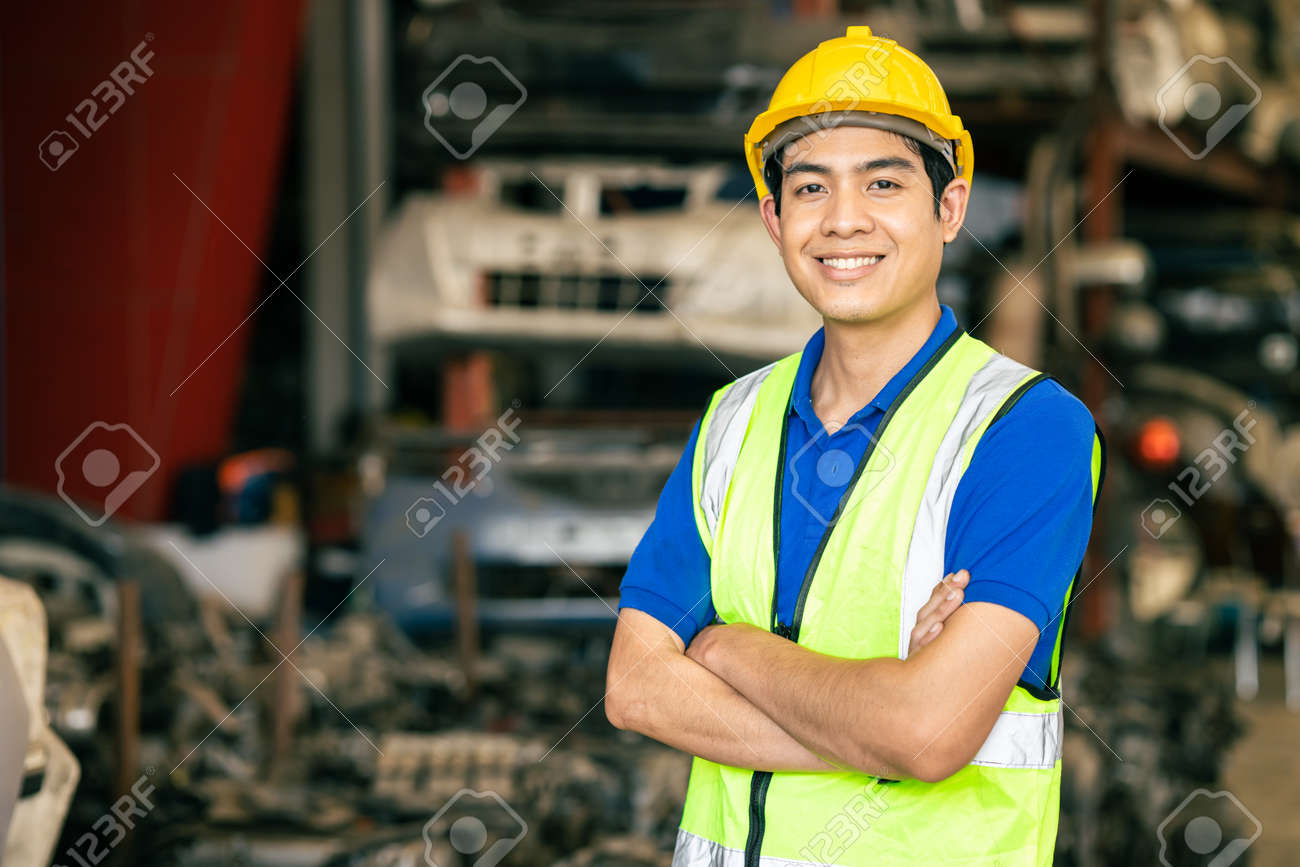confident Asian male engineer worker standing arm crossed happy smile for enjoy working in factory - 167621352