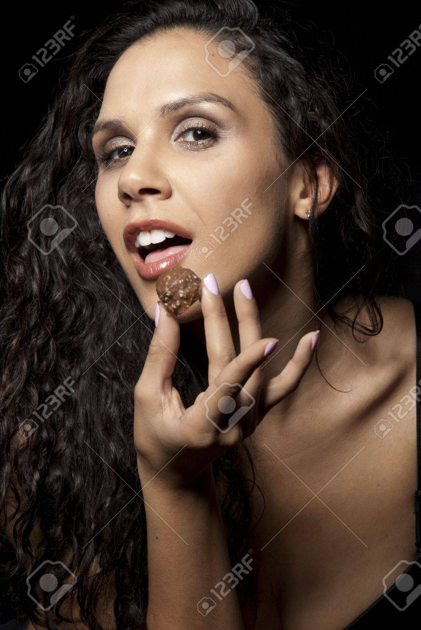 Sexy Female Model Eating Chocolate Stock Photo, Picture And ...
