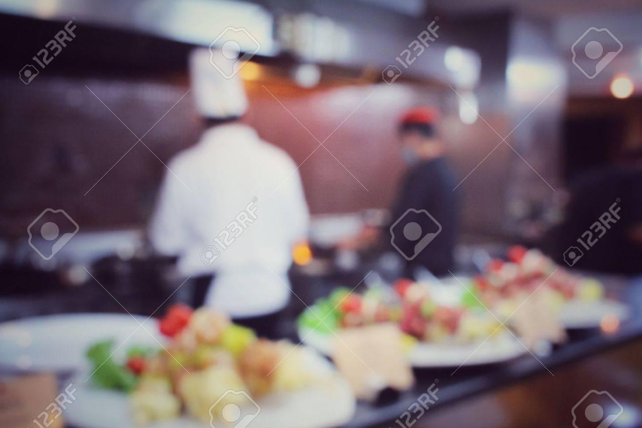 Blurred of chef in restaurant Standard-Bild - 41571260