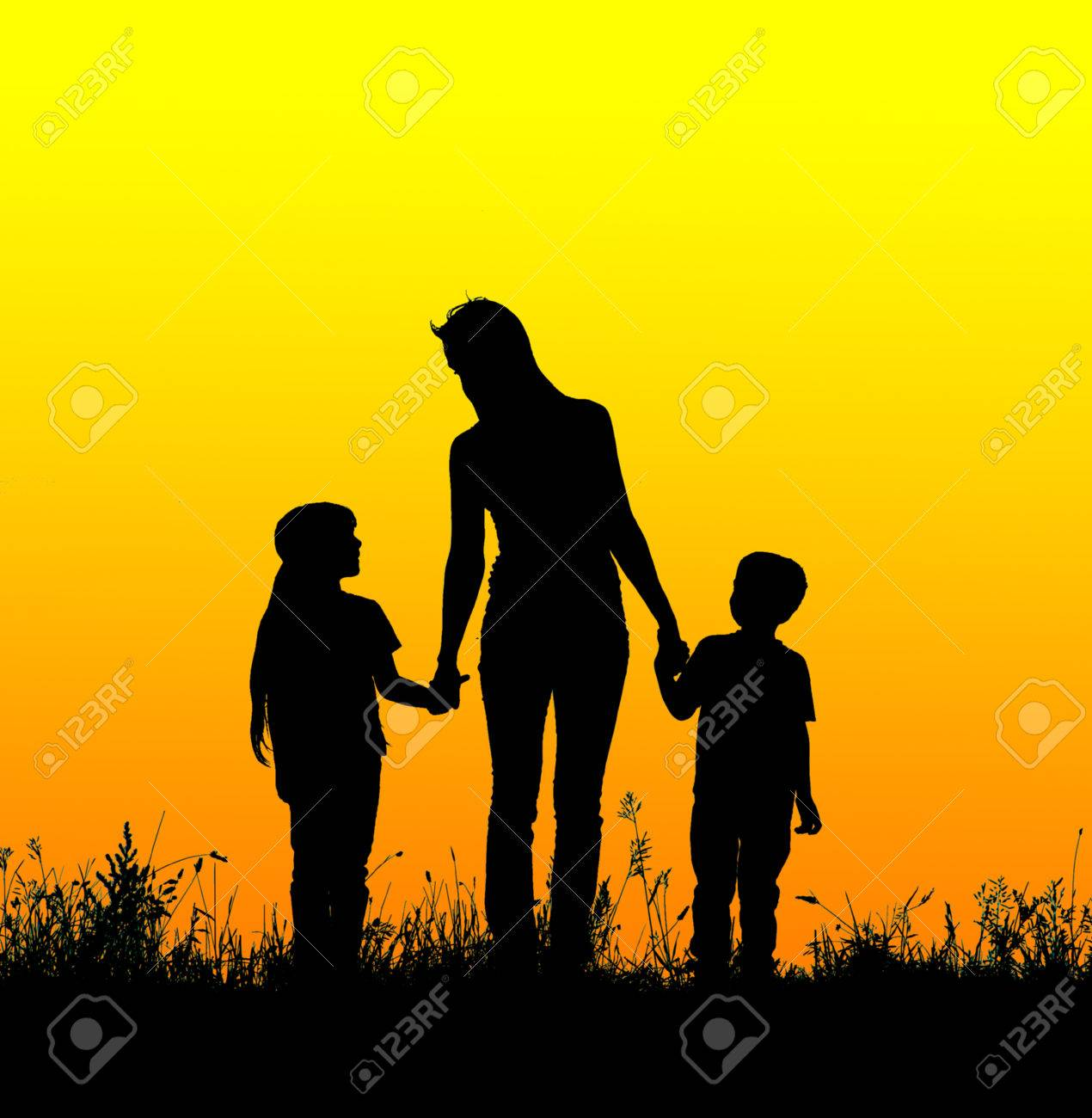 Silhouette Mother And Child Holding Hands At Sunset Stock Photo